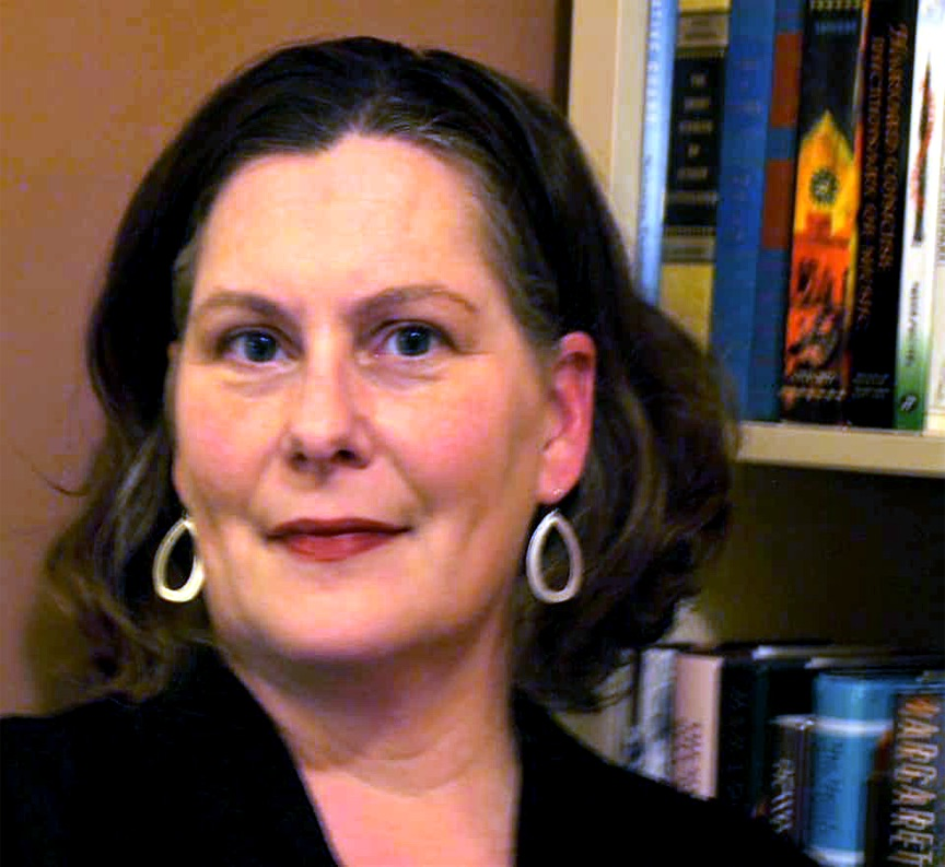 A picture of Jane Zunkel in front of a bookcase