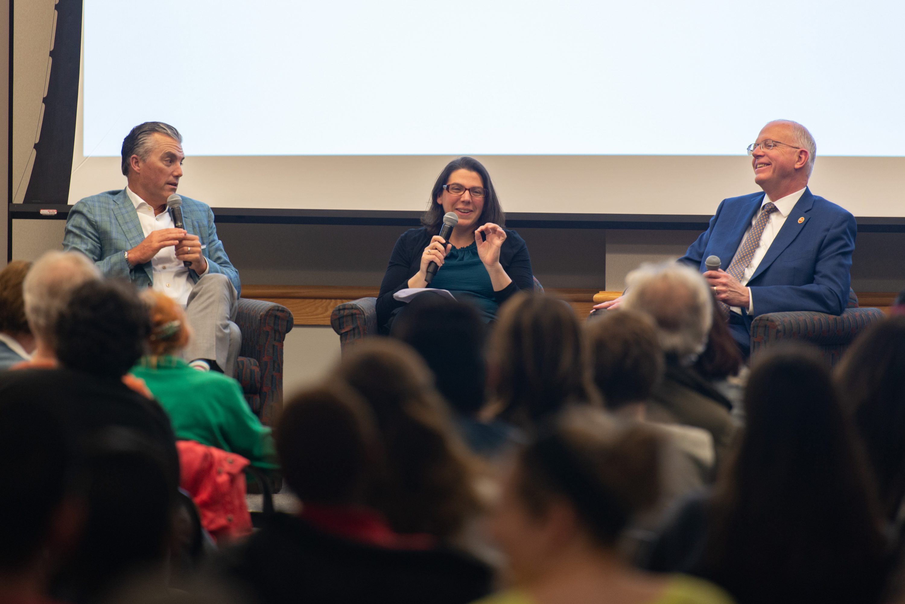 From left to right, Eric Berridge, Amanda Roth, and David C. Munson speak at the May 2019 Monroe Community College Institute for the Humanities.