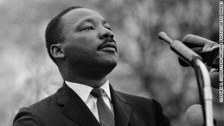 An image of Dr. King in front of a microphone